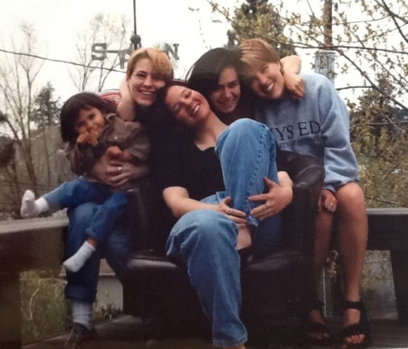 That's me in the center, on the chair.  Natasha is on my right, holding the kid.  The 5 of us lived in a small 2 bedroom house.