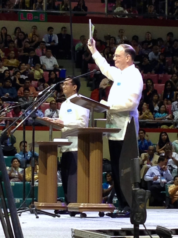 David Splane, a member of the Governing Body, from the world headquarters in Brooklyn, NY, releasing a new Bible study aid.  On the stage with a translator.