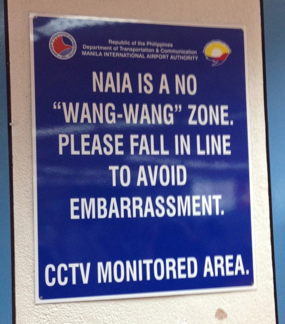 One of the signs in the Manila Ninoy Aquino Airport.  I love getting lost in translation.